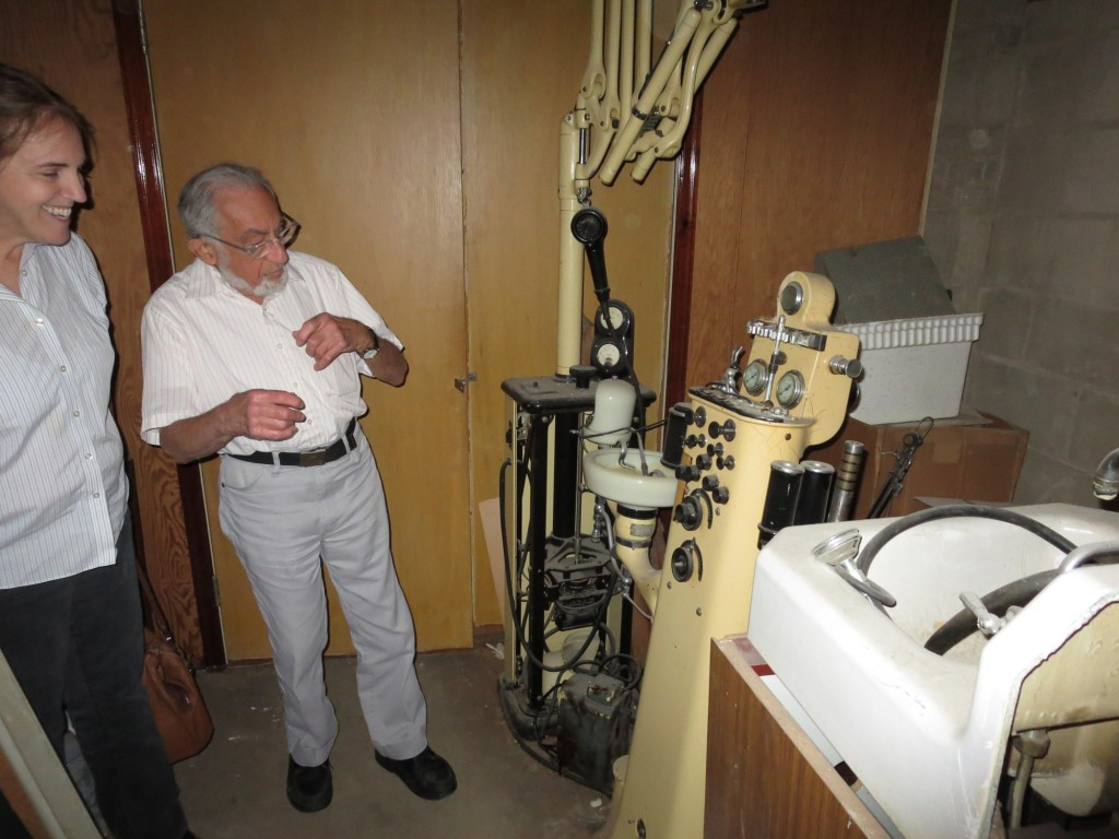 Mr Toretsky of Twin City Monuments shows some old equipment from an old dental office in the building.