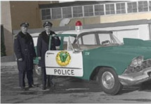 Officer Stimson and squad car 1957